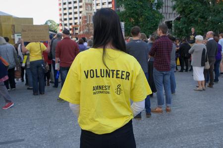 abbott: BRISBANE, AUSTRALIA - JUNE 20: Amnesty International volunteer at World Refugee Day Rally June 20, 2015 in Brisbane, Australia Editorial