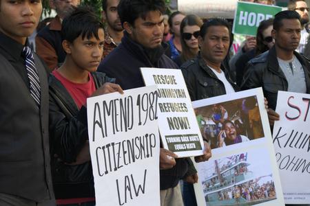 abbott: BRISBANE, AUSTRALIA - JUNE 20 : Burmese Rohingya Association members protesting as part of World Refugee Rally June 20, 2015 in Brisbane, Australia