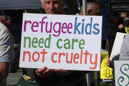 abbott: BRISBANE, AUSTRALIA - JUNE 20: Rally goer holding anti- immigration policy at World Refugee Day Rally June 20, 2015 in Brisbane, Australia