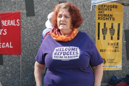 abbott: BRISBANE, AUSTRALIA - JUNE 20: Rally goers wearing anti-immigration poilcy shirt at World Refugee Day Rally June 20, 2015 in Brisbane, Australia
