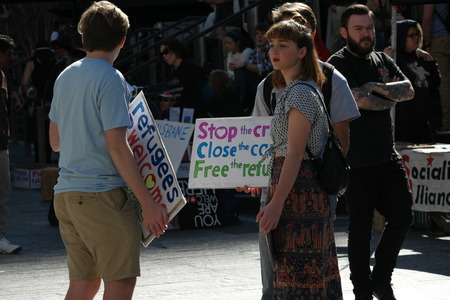 abbott: BRISBANE, AUSTRALIA - JUNE 20: Rally goers holding anti-immigration policy signs during World Refugee Rally June 20, 2015 in Brisbane, Australia