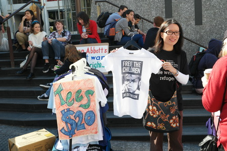 abbott: BRISBANE, AUSTRALIA - JUNE 20: Tshirt stall at World Refugee Rally June 20, 2015 in Brisbane, Australia