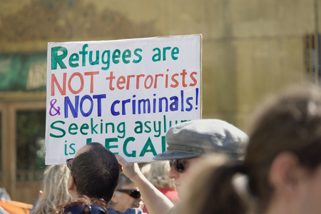 abbott: BRISBANE, AUSTRALIA - JUNE 20: Rally goer holding anti- immigration policy at World Refugee Day Rally June 20, 2015 in Brisbane, Australia