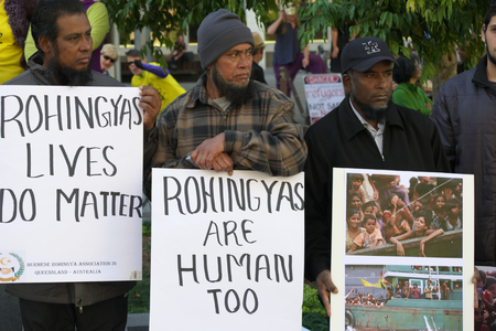 abbott: BRISBANE, AUSTRALIA - JUNE 20 : Burmese Rohingya Association members protesting as part of World Refugee Rally June 20, 2015 in Brisbane, Australia