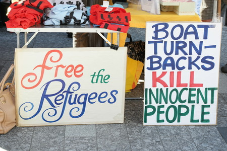 abbott: BRISBANE, AUSTRALIA - JUNE 20: Anti- immigration policy signs at World Refugee Day Rally June 20, 2015 in Brisbane, Australia