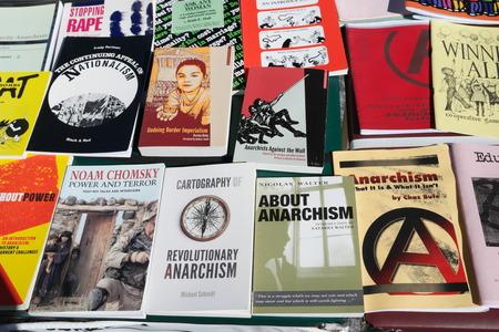anarchist: BRISBANE, AUSTRALIA - JUNE 20: Anarchist books for sale at World Refugee Day Rally June 20, 2015 in Brisbane, Australia Editorial