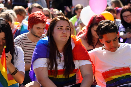 wedding parade: BRISBANE, AUSTRALIA - AUGUST 8 2015: Unidentified rally goer adorned with gay pride flags at Marriage Equality Rally August 8, 2015 in Brisbane, Australia