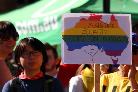 abbott: BRISBANE, AUSTRALIA - AUGUST 8 2015: Anti conservative policy sign at Marriage Equality Rally August 8, 2015 in Brisbane, Australia