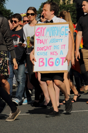 marchers: BRISBANE, AUSTRALIA - AUGUST 8 2015:Street marchers with anti Tony Abbott at Marriage Equality Rally August 8, 2015 in Brisbane, Australia