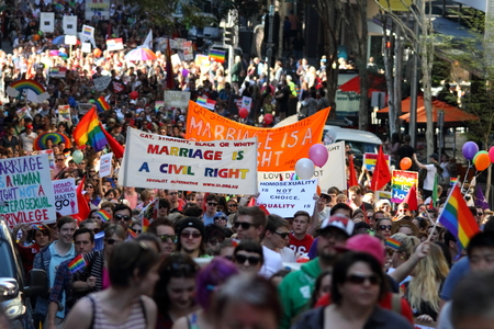 senate elections: BRISBANE, AUSTRALIA - AUGUST 8 2015: Large groups of street marchers pro Marriage Equality Rally August 8, 2015 in Brisbane, Australia