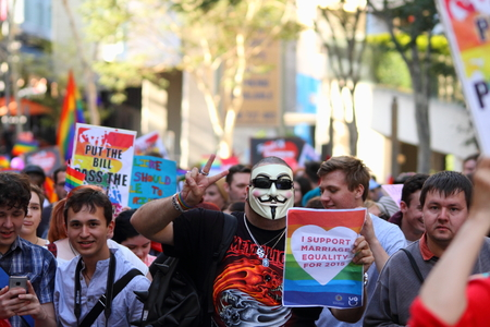 marchers: BRISBANE, AUSTRALIA - AUGUST 8 2015: Large groups of street marchers pro Marriage Equality Rally August 8, 2015 in Brisbane, Australia