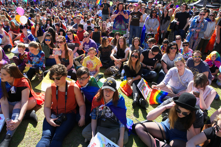 abbott: BRISBANE, AUSTRALIA - AUGUST 8 2015: Crowds gathered to listen to speakers at Marriage Equality Rally August 8, 2015 in Brisbane, Australia Editorial
