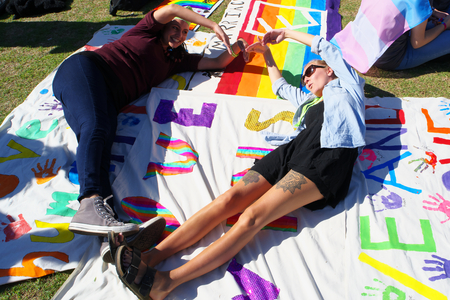 senate elections: BRISBANE, AUSTRALIA - AUGUST 8 2015:Unidentified rally goers making love symbol on banners at Marriage Equality Rally August 8, 2015 in Brisbane, Australia