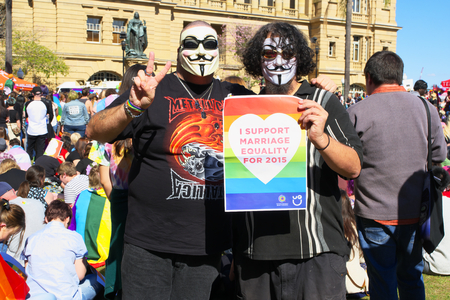 abbott: BRISBANE, AUSTRALIA - AUGUST 8 2015: Anonymous pro marriage equality supporters at rally August 8, 2015 in Brisbane, Australia Editorial
