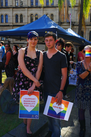 abbott: BRISBANE, AUSTRALIA - AUGUST 8 2015: Unidentified rally goers with support placards of Marriage Equality Rally August 8, 2015 in Brisbane, Australia Editorial