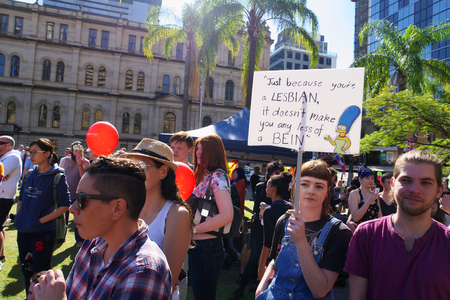 marge: BRISBANE, AUSTRALIA - AUGUST 8 2015: Unidentified rally goers with support placards of Marriage Equality Rally August 8, 2015 in Brisbane, Australia Editorial