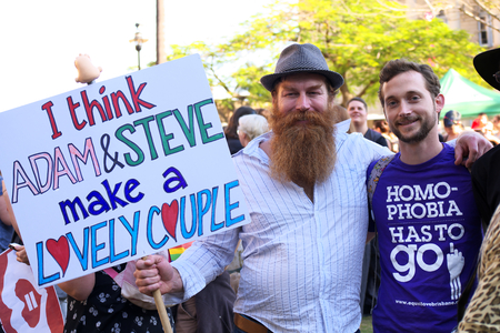homophobia: BRISBANE, AUSTRALIA - AUGUST 8 2015:Unidentified rally goers with pro-gay marriage sign at Marriage Equality Rally August 8, 2015 in Brisbane, Australia Editorial