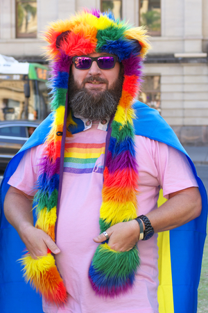 senate elections: BRISBANE, AUSTRALIA - AUGUST 8 2015:Unidentified rally goer dressed as rainbow bear at Marriage Equality Rally August 8, 2015 in Brisbane, Australia