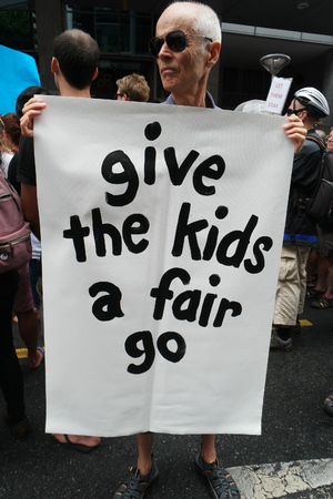 BRISBANE, AUSTRALIA - FEBRUARY 05 :Anti children in detention sign at protest in support of churches offering sanctuary to refugees February 05, 2016 in Brisbane, Australia
