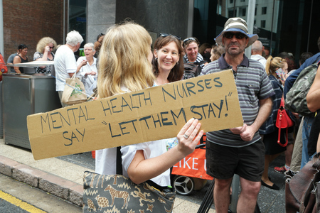 BRISBANE, AUSTRALIA - FEBRUARY 05 :Health worker sign at protest in support of churches offering sanctuary to refugees February 05, 2016 in Brisbane, Australia
