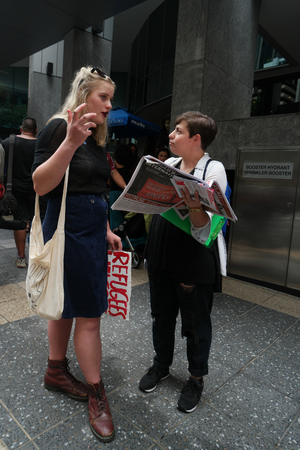 abbott: BRISBANE, AUSTRALIA - FEBRUARY 05 : Anti right wing newspaper seller at protest in support of churches offering sanctuary to refugees February 05, 2016 in Brisbane, Australia