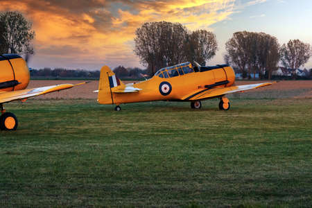 Beautiful view of French vintage planes in the meadow.