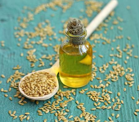 linseed oil in bottle on wooden background, close-up Stock Photo - 17191902