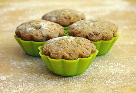 Delicious cupcakes in tins for baking, close-up