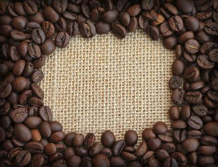 robusta: Frame of coffee beans on canvas background, close-up