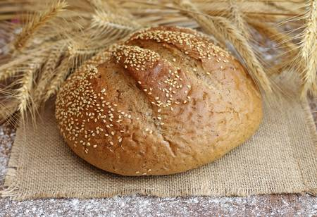 tasty bread with spikelets, close-up photo
