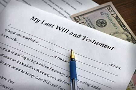 Last Will and Testament form with pen, close-up photo