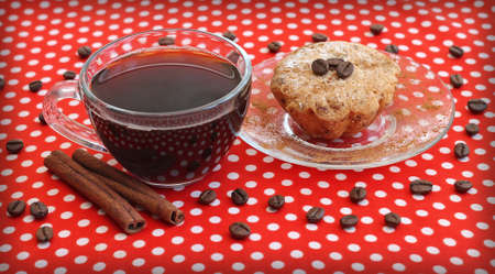 Coffee cup and cake on saucer, close-up photo