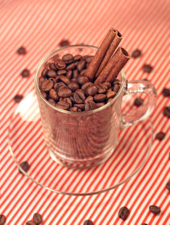 coffee beans in a glass cup with cinnamon, close-up photo
