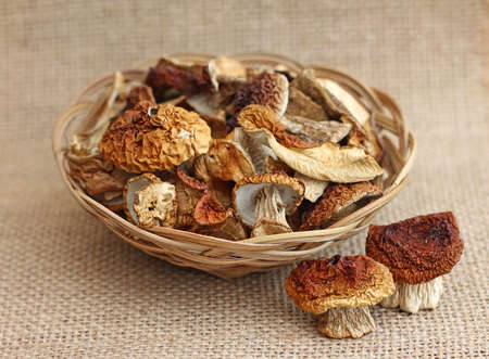 fungous: Dried mushrooms in wicker basket, close-up