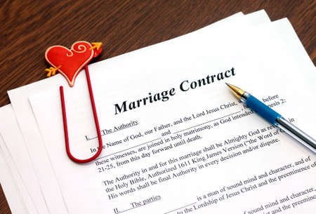Marriage contract with pen, close-up photo