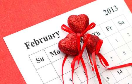 Valentines Day in calendar with red hearts, close-up photo