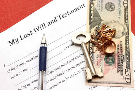ones last will and testament with gold and money, close-up photo