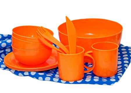 tupperware: Set of orange plastic utensils for picnic on colorful napkin