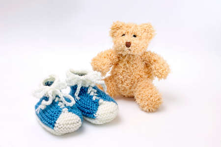 Gift for birth of boy - little booties and teddy bear photo