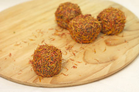 delight: East sweets. Fruit candies sprinkled with saffron, close-up