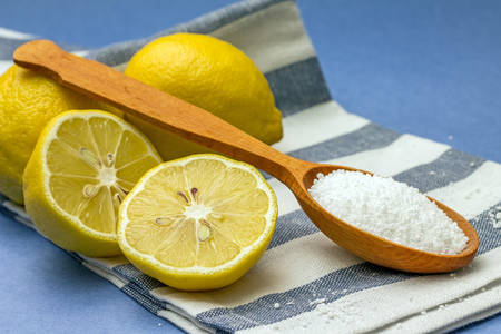 citric acid: Studio photo of citric acid and lemons, on blue background