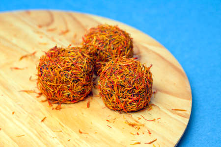 Bright candies made of saffron and chocolate, close-up Stock Photo