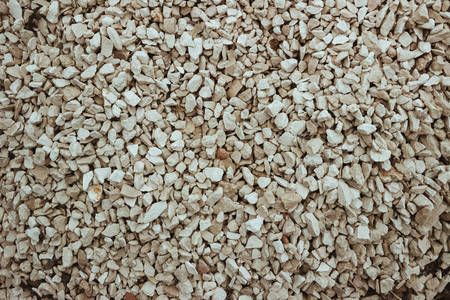 Gravel background. Horizontal image of stones, close-up