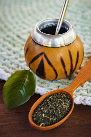Vertical photo of calabash with mate tea and bombilla
