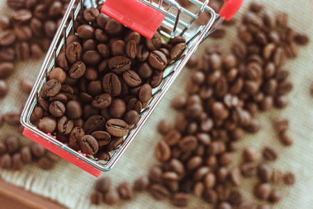 Studio image of coffee beans in a grocery trolley