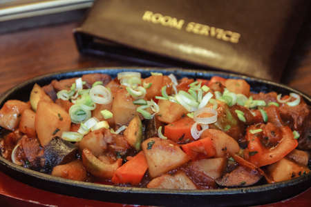 Room service. Image of ragout in a pan, close-up