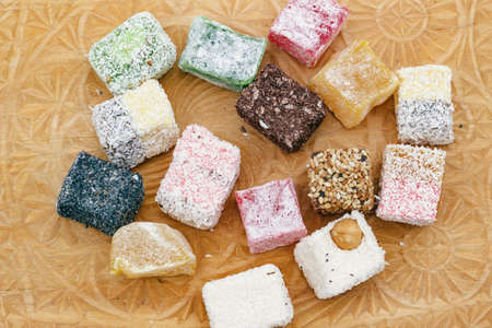 Top view of delicious Turkish delight on a wooden board