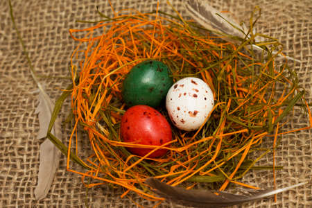 Easter. Colorful nest full of chocolate quail eggs, close-up Reklamní fotografie