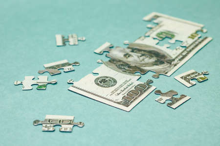 Finance concept. Image of Dollar bill puzzle, close-up