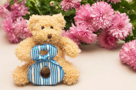 March 8. Photo of teddy bear with flowers